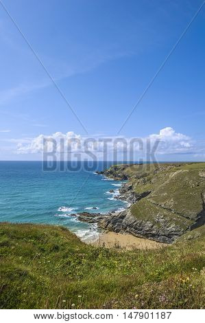 Bedruthan steps beach in Cornwall UK on a sunny summer day