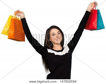 Friendly Young Woman Holding Shopping Bags with Arms Raised - Isolated
