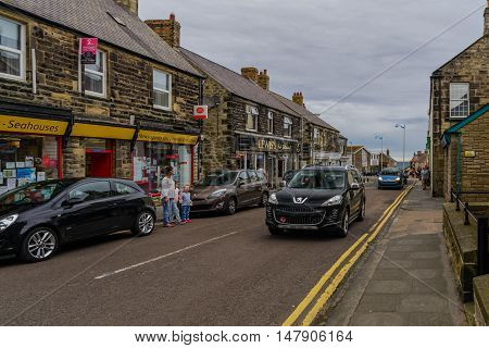 AUGUST 11, 2016--SEAHOUSES, ENGLAND-- Tourists explore the village of Seahouses.  . Seahouses serves the tourist trade, being the embarkation point for visits to the Farne Islands.