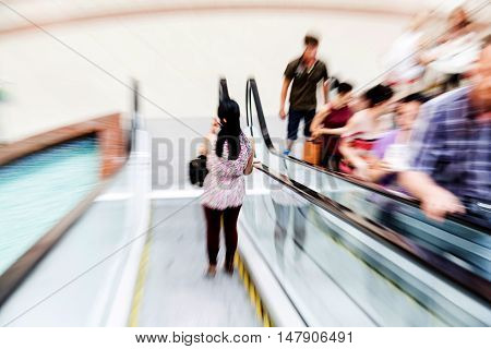 People on Escalators in Modern Shopping Mall