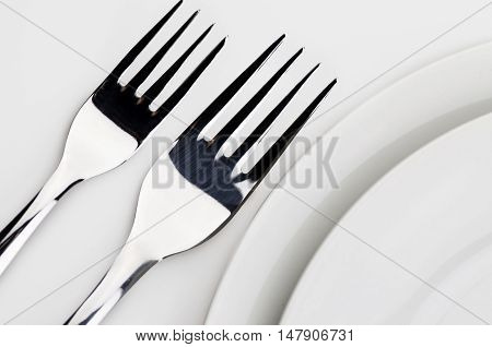 Close up of forks in a place setting