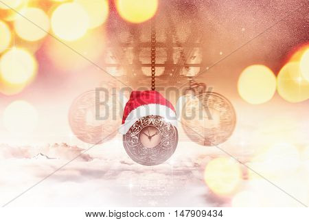 Hypnotising watch on a chain swinging above clouds and a Santa hat. Time left before Christmas