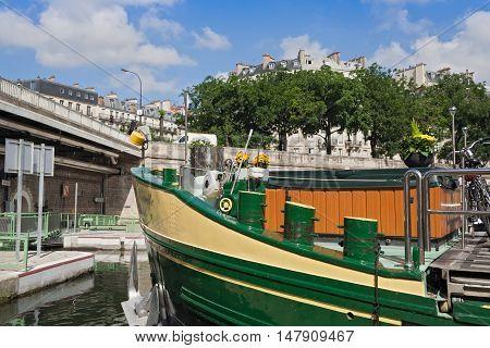 PARIS, FRANCE-AUGUST 06, 2016: boat in the Bassin de l Arsenal west of the Place de la Bastille