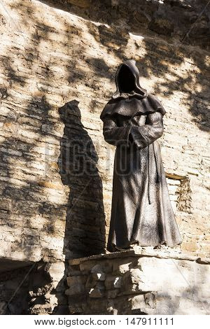 TALLINN ESTONIA - SEPTEMBER 09 2016: Monk sculptures in the Danish king garden in the old town of Tallinn Estonia on September 09 2016