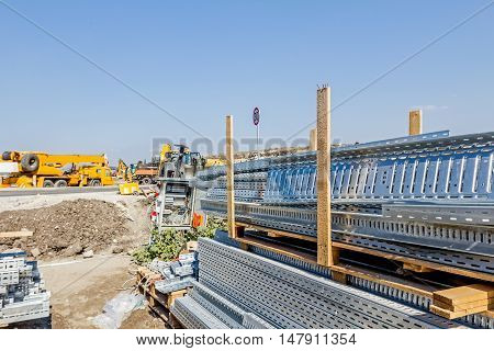 Cable trays for different usage at construction site in the improvised warehouse.
