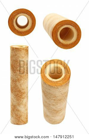 Used dirty rusty brown home sediment drinking water filter cartridge replacement for filtration and purification at pre-filter system isolated on white background close up