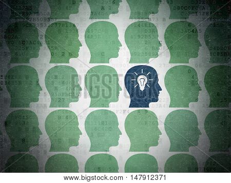 Finance concept: rows of Painted green head icons around blue head with light bulb icon on Digital Data Paper background