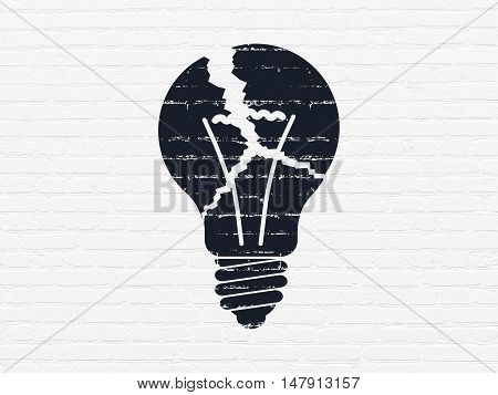 Business concept: Painted black Light Bulb icon on White Brick wall background