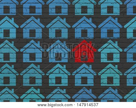 Security concept: rows of Painted blue home icons around red home icon on Black Brick wall background