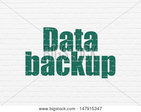 Data concept: Painted green text Data Backup on White Brick wall background