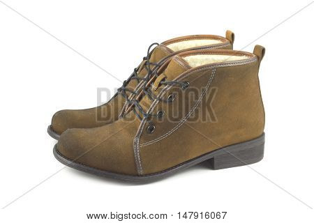 Two beautiful woman's brown suede boots isolated on white side view closeup