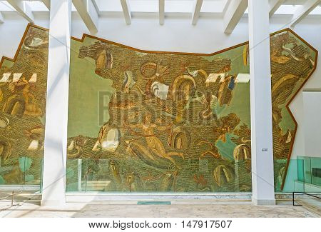 TUNIS TUNISIA - SEPTEMBER 2 2015: The large mosaic panel on the wall in Bardo National Museum with the sea creatures dolphins and Venus on September 2 in Tunis.