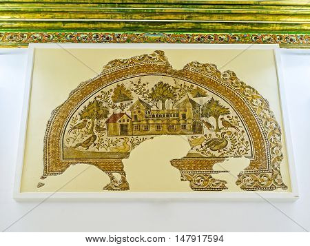 TUNIS TUNISIA - SEPTEMBER 2 2015: The ancient mosaic depicts the Roman villa surrounded by forest full of birds Sousse Room of Bardo National Museum on September 2 in Tunis.