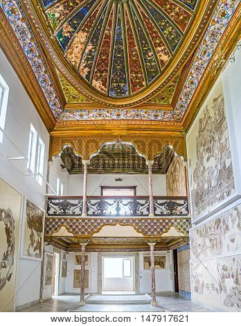 TUNIS TUNISIA - SEPTEMBER 2 2015: Two storied gallery of the Althiburos Room of Bardo National Museum with the richly decorated ceiling and arches on September 2 in Tunis.