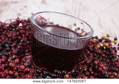 Bunch Of Fresh Elderberry With Juice On Old Wooden Background, Healthy Nutrition