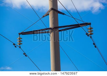 Intermediate transmission line costs against the sky close-up on a clear sunny day. power transmission by means of electric current.