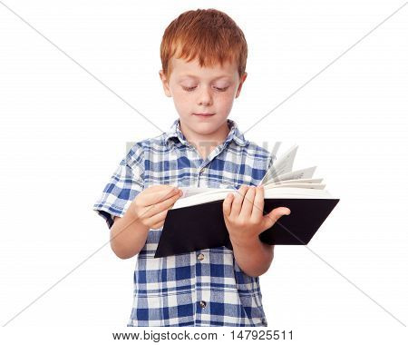 Little studious boy reading a book isolated on white background