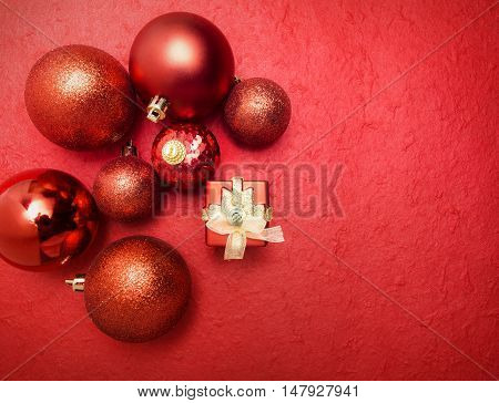 Red Chrismas Ball And Gift On Red Background