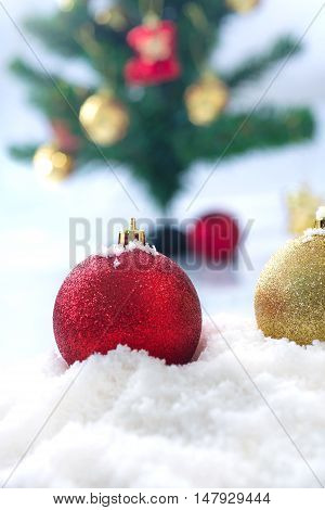 Red Chrismas Ball On Snow With Chrismas Tree Background