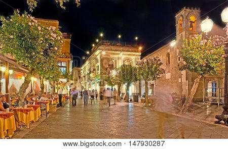 TAORMINA ITALY - OCTOBER 1 2012: The Square of IX Aprile is the best place for supper in luxury restaurant or cozy cafe enjoy the views or walk to the central town promenade - Corso Umberto on October 1 in Taormina.