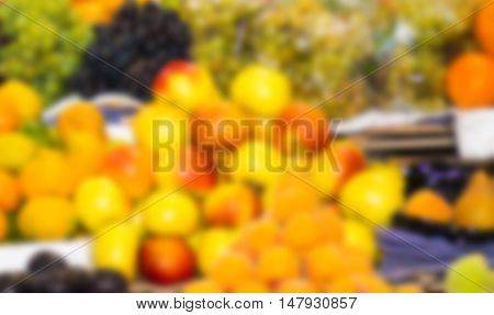 Colorful selection of different fresh delicious fruits and vegetables spread out, blurry effect.
