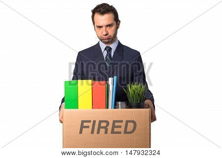 Fired businessman with box isolated on white background