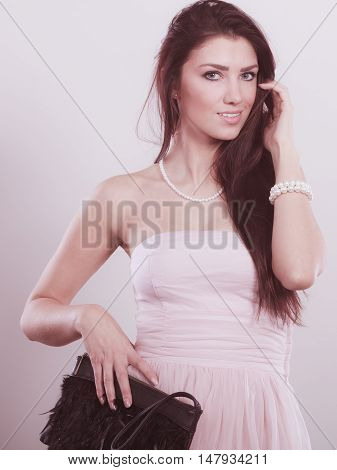 Brunette Woman In Bright Dress With Clutch Bag