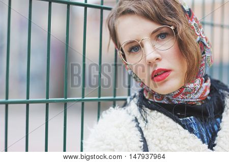 Charming Sweet Young Girl Slav In A Beautiful Scarf And Trendy Sunglasses On The Background Of The F