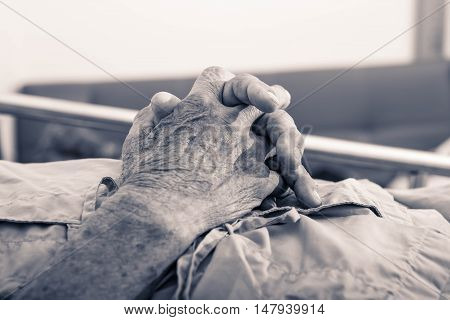 old man hand sleeping in a hospital