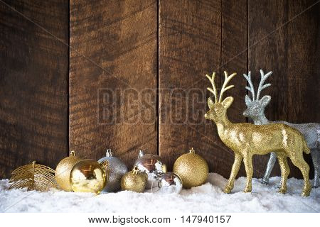 christmas gold silver ball and reindeer decoration with wood background