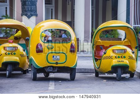 HAVANA CUBA - JULY 18 : A Cocotaxis in old Havana street on July 18 2016. Cocotaxi is an auto rickshaw type taxi vehicle a cheap way to go from one point to the other in Havana.