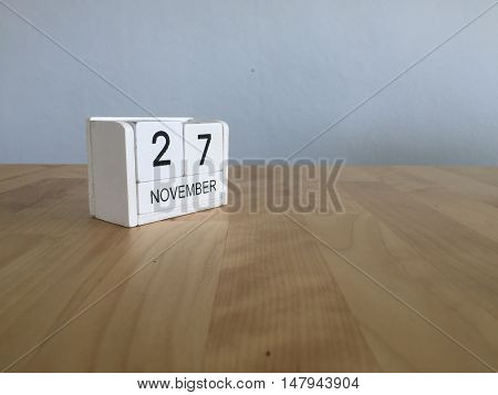 November 27Th. November 27 White Wooden Calendar On Vintage Wood Abstract Background.autumn Day.copy