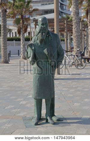 SAN JUAN ALICANTE SPAIN - AUGUST 29: bronze statue of two elderly looking into infinity. Picture taken on August 29 2016 in San Juan beach Alicante Spain