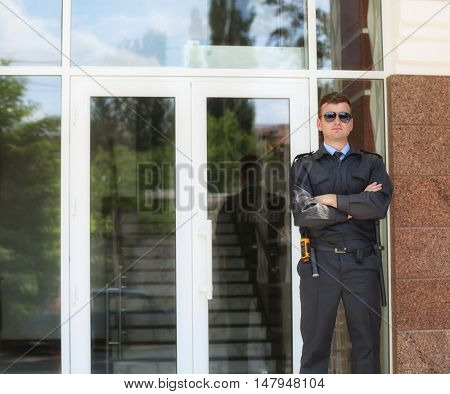 Male security guard outdoors