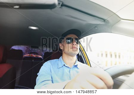 Male taxi driver in car
