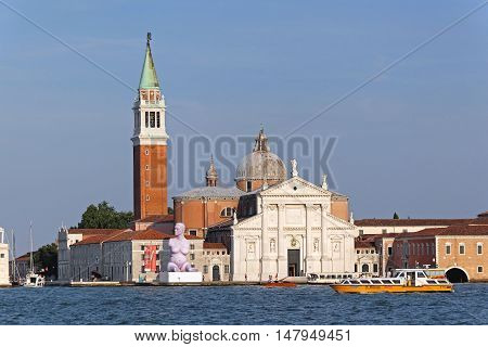 VENICE ITALY - JULY 08: San Giorgio Maggiore in Venice on JULY 08 2013. Modern art sculpture at island San Giorgio Maggiore in Venice Italy.
