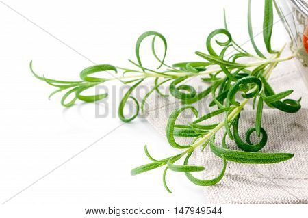 rosemary with linen napkin decor close-up on white  background