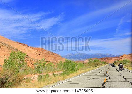 Motorcycles vacationing through beautiful Glen Canyon National Park, Utah