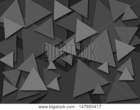 An abstract digital pattern created with triangles of various sizes in shades of grey with a three dimensional effect.