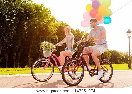 Happy Couple In Love Riding Bicycles And  Having Fun