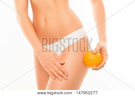Close Up Of Woman In Panties With Orange  Massagin Skin On Leg