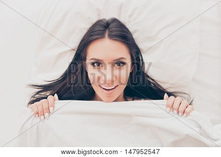 Pretty Smiling Woman Lying In Bed And Covering Blanket At Morning