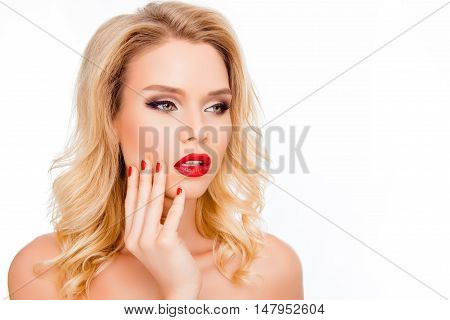 Portrait Of Pretty Young Blonde With Red Lips Touhing Face