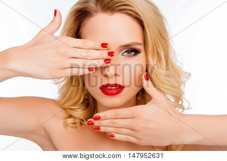 Pretty Woman Holding Hands Near Face And Showing Beautiful Palms