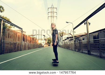 Young Girl Skateboard Outdoors Urban Concept
