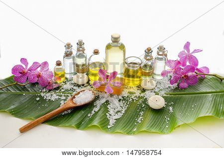 Spa set on banana leaf with branch orchid ,massage oil