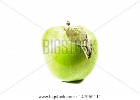 Fresh green apple on a white background
