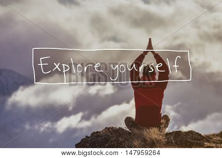 Yoga man sits on the cloudy sky backdrop. Table explore yourself