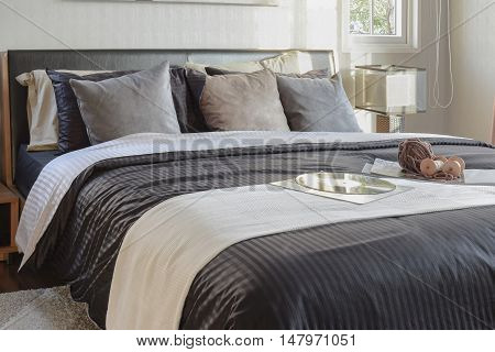 Modern Black Tone Bedroom Decorative With Book, Crochet And Gramophone Record On Bed