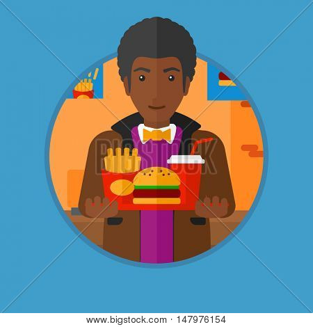 An african-american man holding tray full of junk food. Man in fast food restaurant. Man having lunch in a fast food restaurant. Vector flat design illustration in the circle isolated on background.